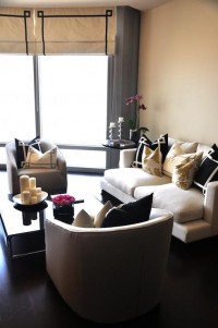 living rooms - Caitlin Wilson Textiles white sofa black greek key pillows steel gray Greek key pillows chunky square mirrored coffee table gray curvy chairs natural roman shades black Greek key trim round black glossy table orchid