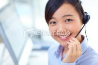 pretty customer service looking at | Stock Photo | iStock