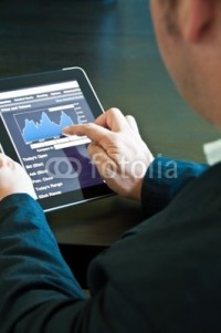 Photo: Businessman with digital tablet PC © Frank Gärtner #25192367
