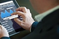 Photo: Businessman with digital tablet PC © Frank Gärtner #25192269