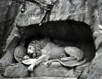 Symbolic Lion Sculpture Carved Laying in a Cliff - My Modern Metropolis