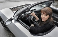 Stargate actress test drives Tesla Roadster