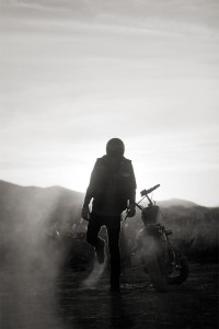 Silhouetted rider next to his bike | Murray Mitchell