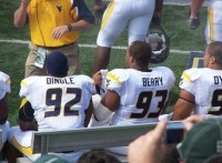 Football Players Spelling Out A Message