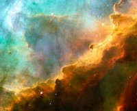 HubbleSite - Picture Album: A Perfect Storm of Turbulent Gases in the Omega/Swan Nebula (M17)