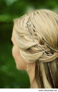 Delicate rhinestone chain woven into a romantic braided bohemian style bridal hairdo - LikeaLady.net