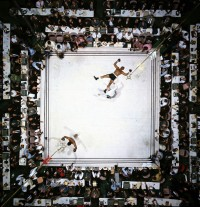 Muhammad Ali beating Cleveland Williams by Neil Leifer