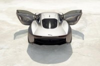 Official: Jaguar C-X75 Hybrid Supercar goes into Production: Wallpaper Jaguar C-X75 Hybrid Supercar rear angle above view on desert | Roogio.com