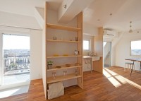 Wooden wing walls divide spaces in Tokyo apartment by Camp Design Inc