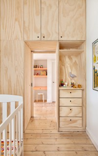 Flinders Lane Apartment by Clare Cousins has a timber box of bedrooms