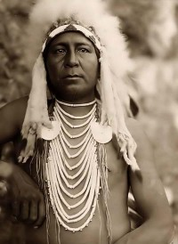 Crow Brave Wearing a Head Dress