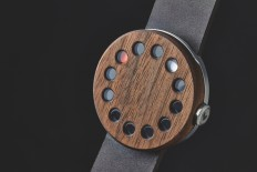 wooden analog watch by grovemade displays time through glass windows