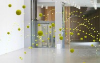 2,000 Suspended Tennis Balls Appear to Bounce Through Mustang Art Gallery | Colossal