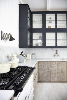 navy top cabinets + natural wood cabinets below + subway tile in glass front cabinet | via Modern & Classic Kitchens ~ Cityhaüs Design | home | Pinterest