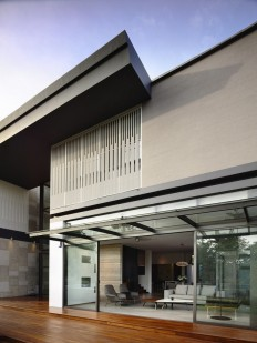 Slatted Facade House With Sleek Adjoined Apartment | Modern House Designs