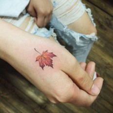 Platanus leaf tattoo on the right hand.Done by Doy