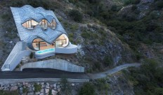 The Homes Have Eyes: The 'House On The Cliff' Home Features A Curved Roof Made Of Zinc