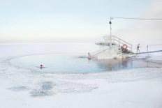 Winter Swimming in The Frozen Lake by Markku Lahdesmaki