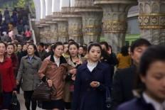 Photographer Runs The Pyongyang Marathon To Document North Korea