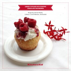 Lemon Cupcakes With Whipped Cream And Raspberries