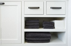 Stocksy United – Royalty-Free Stock Photos – Detail of towels on bathroom shelf by Trinette Reed