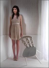 fashion-model-in-studio-set-with-falling-chair-lg.jpg (462×640)