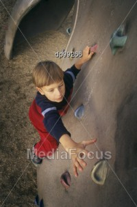Stock Photo Young Boy Ascending Climbing - Image DP99266 - Young Boy Ascending Stock Photography