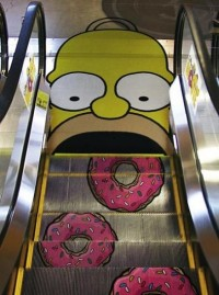 homer eats some donuts on the escalator - technabob — Designspiration