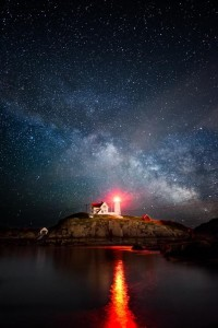 Planet Earth & Space & Outdoor Splendor / Amazing Picture. Milky Way over the Nubble Lighthouse in Cape Neddick Maine by Moe Chen